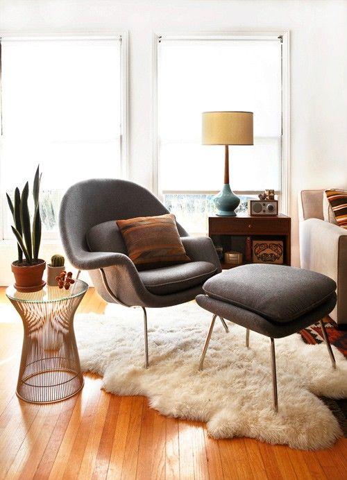 Cancer astrology home decor   Black leather mid-century modern chair flokati rug blue lamp living room   Girlfriend is Better
