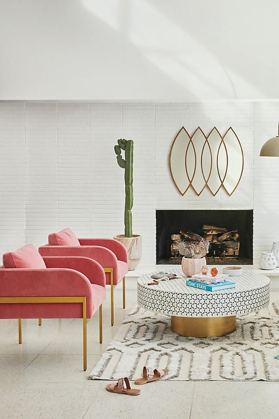 Leo astrology home decor guide | Mid-century modern living room pink armchairs gold accents round table living room | Girlfriend is Better