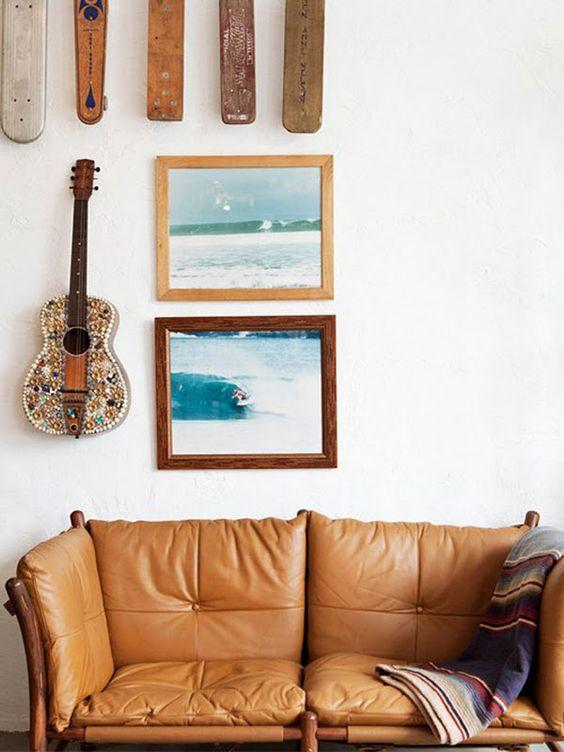 wood element Feng Shui   Bohemian tan leather sofa surf gallery wall frames   Girlfriend is Better