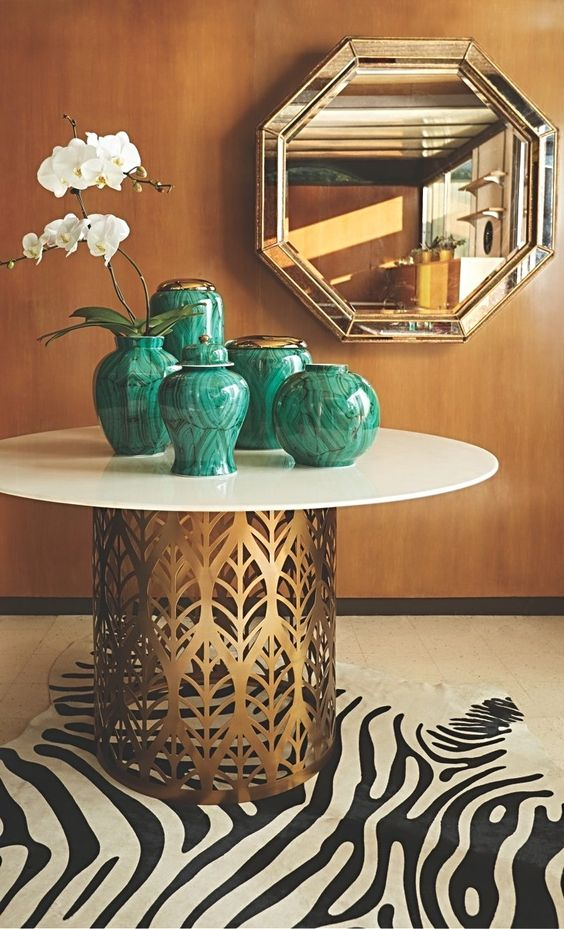 chinoiserie malachite vases   laser-cut brass metal dining table zebra area rug   Girlfriend is Better