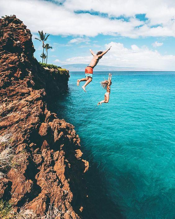 Oahu Hawaii kids cliff jumping ocean   Girlfriend is Better