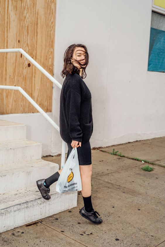 Mitski   Mitski walking down stairs holding plastic bag   Girlfriend is Better