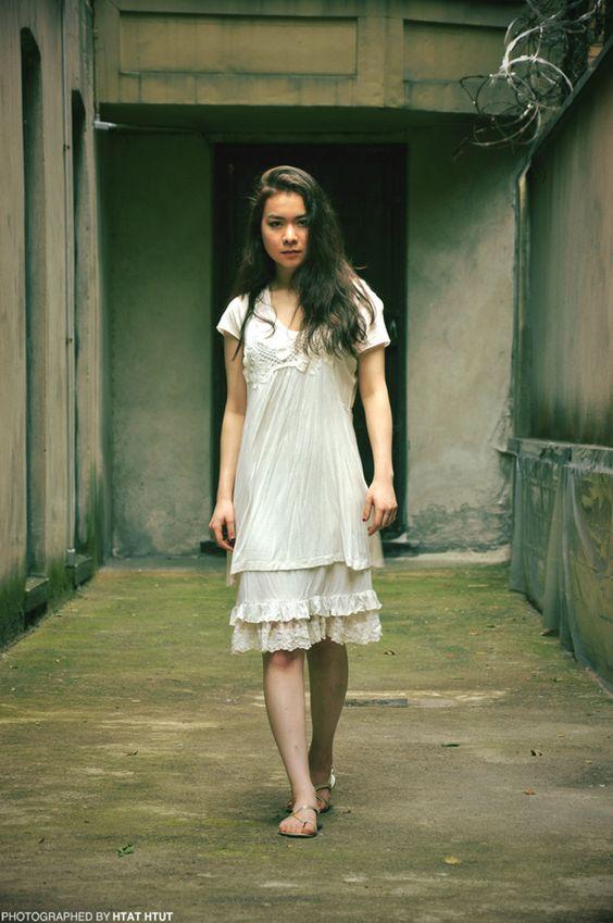 Mitski   Mitski in a white dress standing in a concrete room   Girlfriend is Better