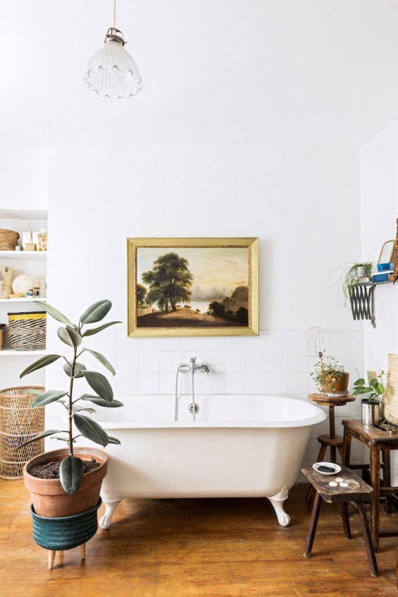 rubber plant | Bohemian decor bathroom claw foot tub terracotta pot | Girlfriend is Better