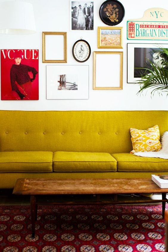 Gold Sofas | mid-century modern yellow couch gallery wall red area rug | Girlfriend is Better