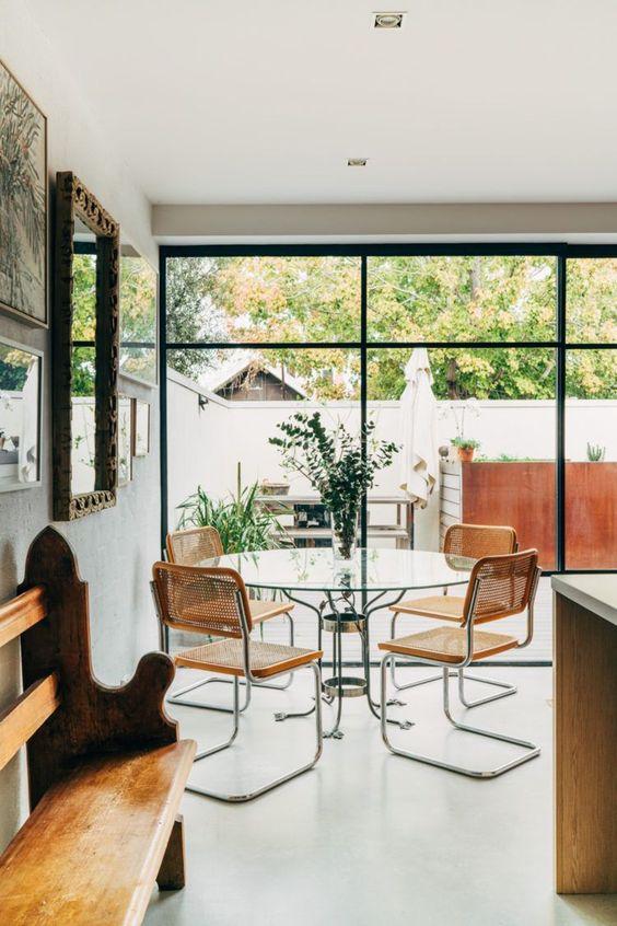 Breuer style chairs   glass table facing lush backyard   Girlfriend is Better