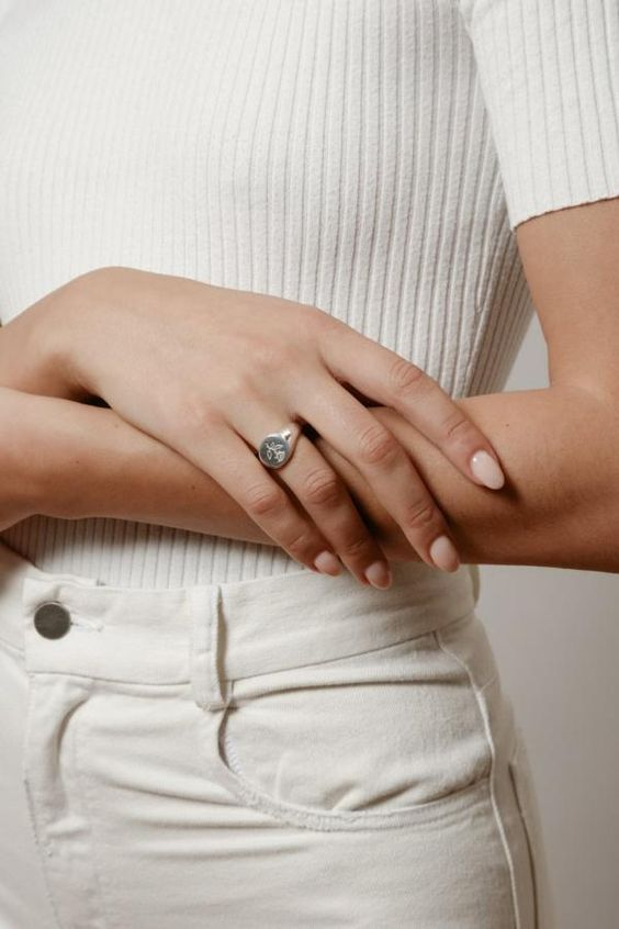 gold signet ring | chic woman with arms crossed | Girlfriend Is Better