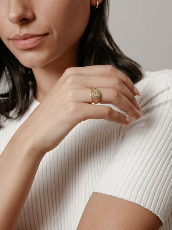 gold signet ring | woman displaying hand | Girlfriend Is Better