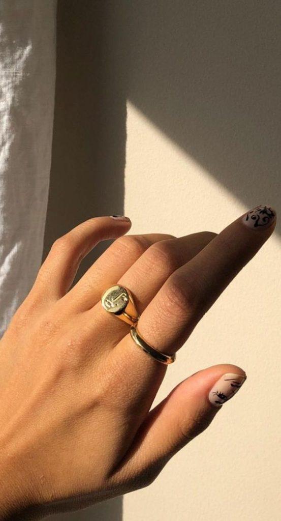 gold signet ring | sun shining on tan hand | Girlfriend Is Better