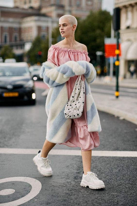 Valentine's Day street style outfits | pink ruffles mumu dress striped faux fur coat white tennis shoes | Girlfriend is Better