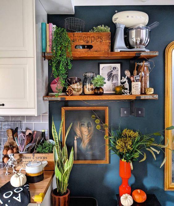 Southern Bohemian   open shelving kitchen dark blue wall paint portrait random person   Girlfriend is Better