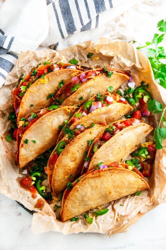 tacos   fried cheesy potatoes in split paper sack   Girlfriend is Better