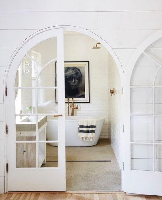 white interiors | French doors bathroom bathtub minimalism | Girlfriend is Better