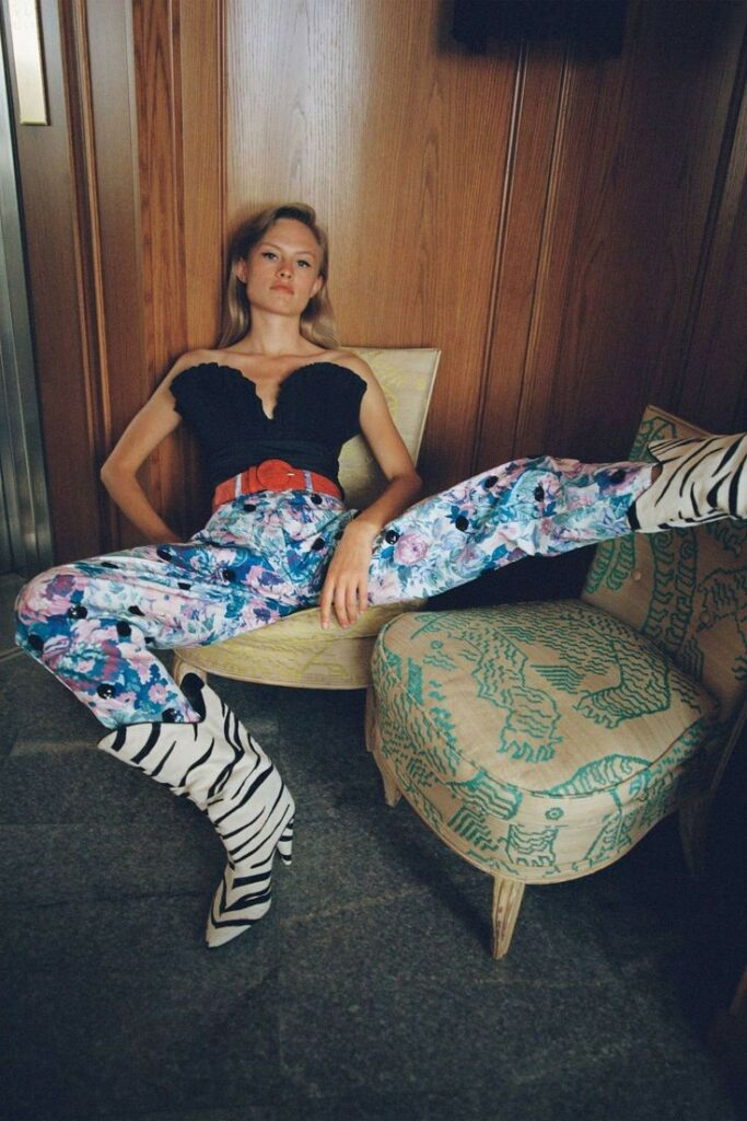 80s street chic | print mixing floral pants zebra animal boots red wide belt | Girlfriend is Better