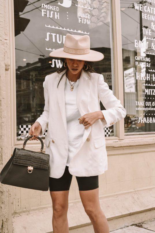 bike shorts | white oversized double-breasted blazer felt hat top handle purse | Girlfriend is Better