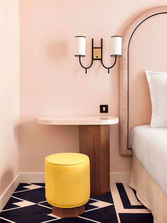Parisian art deco   pink bedroom wall sconce yellow modern stool graphic tile   Girlfriend is Better