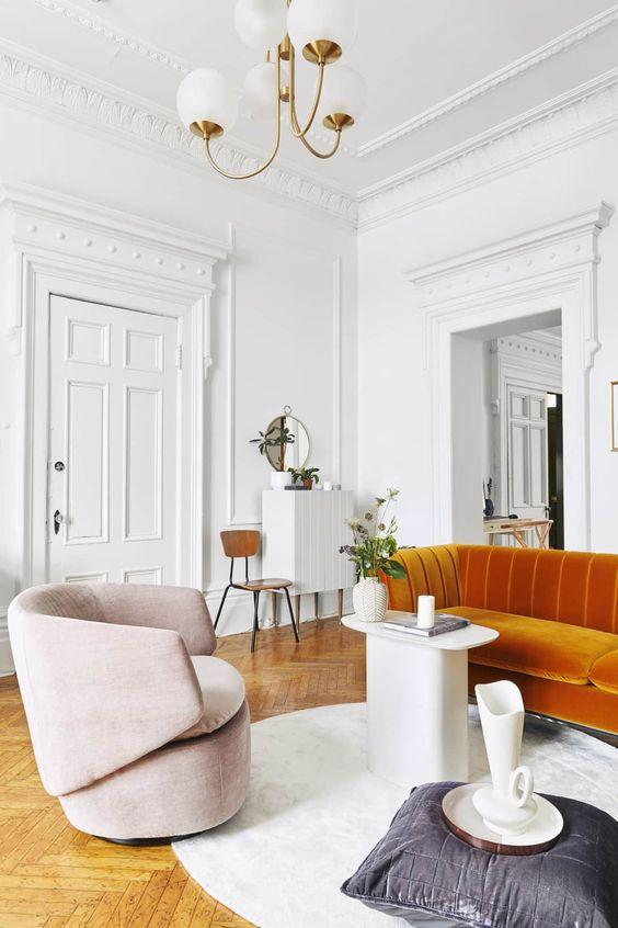 Parisian art deco   orange sofa herringbone flooring wall moulding modern chandelier   Girlfriend is Better