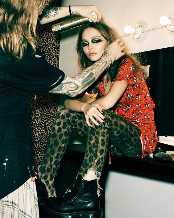 modern grunge | Lily Rose Depp black boots smoky eye shadow cheetah cropped pants floral print dress 90s | Girlfriend is Better