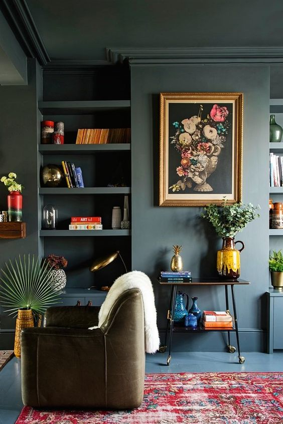 built-in bookshelves   French country dark wall paint vintage area rug fat lava glazed pottery   Girlfriend is Better