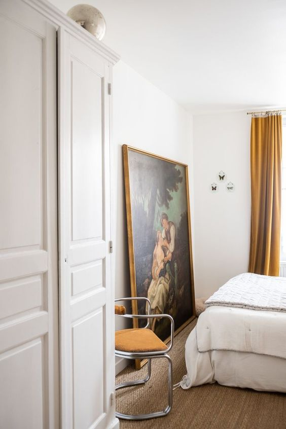 displaying art | large oversized painting leaning Bohemian bedroom Breuer style chair | Girlfriend is Better