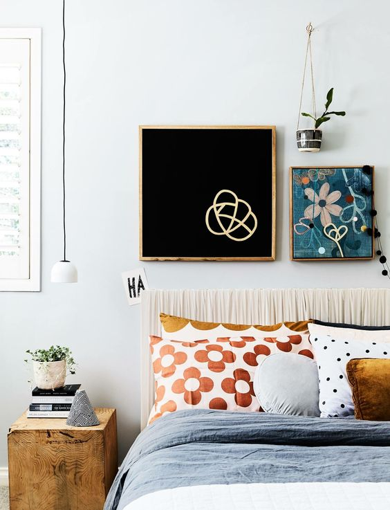 displaying art | Bohemian bedroom paintings hanging plant | Girlfriend is Better