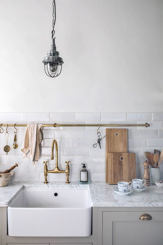 kitchen utility hooks | vintage brass fixtures hanging rod cleaning sink | Girlfriend is Better