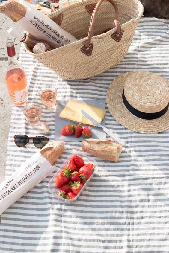 Spring picnic | baguette strawberries cheese wine straw hat purse | Girlfriend is Better