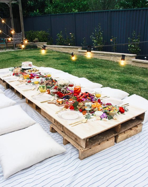 Spring picnic | backyard party patio string lights pillows pallets | Girlfriend is Better