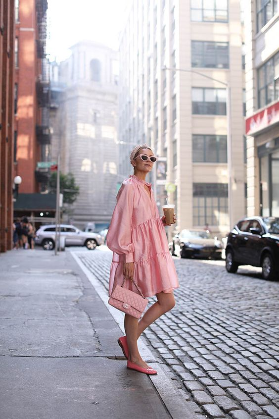 balloon sleeves | pink ruffled party dress street style tiered ruffles top handle purse flats | Girlfriend is Better