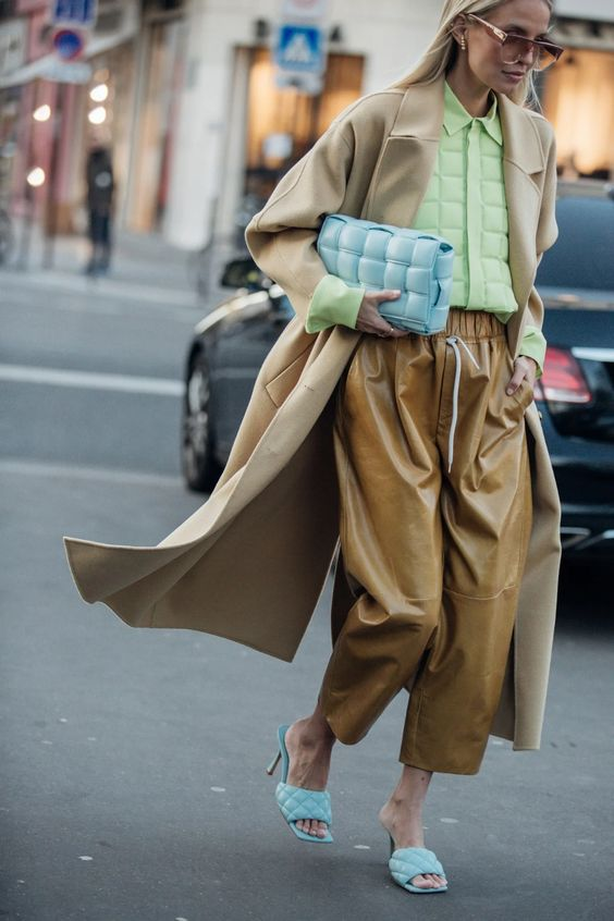 oversized woven purses | light blue padded clutch menswear work outfit trench coat street style | Girlfriend is Better