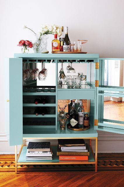 bar cart styling | lacquered cabinet mirror panels glassware liquor tray | Girlfriend is Better