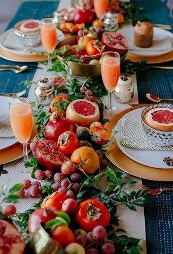 table settings bohemian eclectic | blood orange brunch mimosas pomegranate centerpiece | Girlfriend is Better