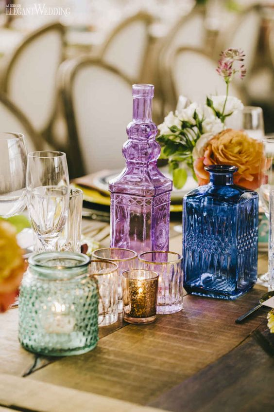 table settings Bohemian eclectic | vintage colored bottles candles centerpiece summer entertaining | Girlfriend is Better