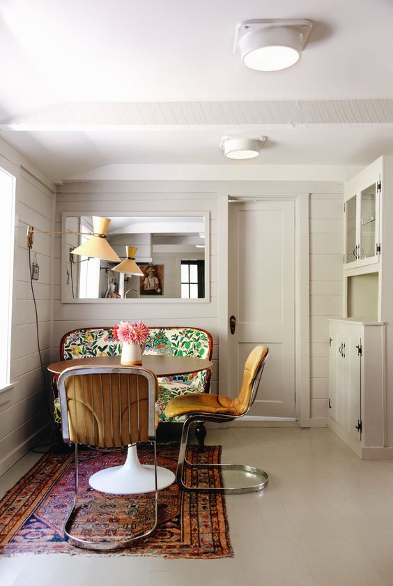 bench seating | French country antique dining Breuer style chairs area rug | Girlfriend is Better