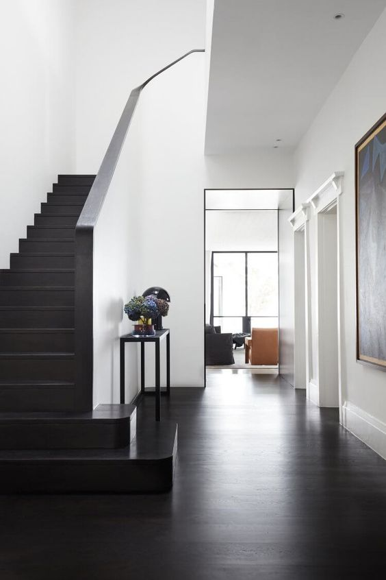 black floors | entryway dark staircase modern elegance | Girlfriend is Better