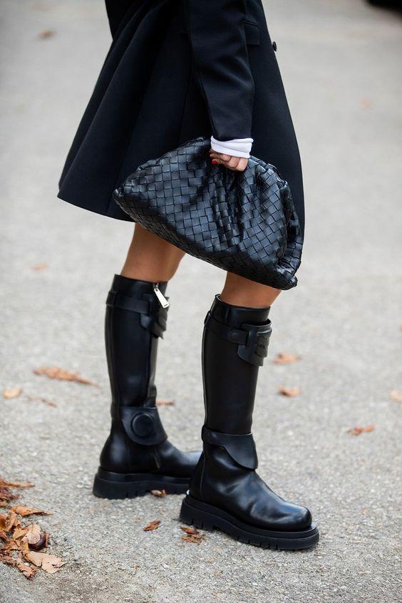 chunky black boots | winter street style knee-high oversized clutch | Girlfriend is Better