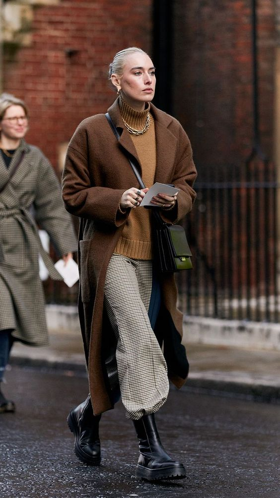 chunky black boots | combat stomping tucked in slacks full-length coat turtleneck sweater neutrals | Girlfriend is Better
