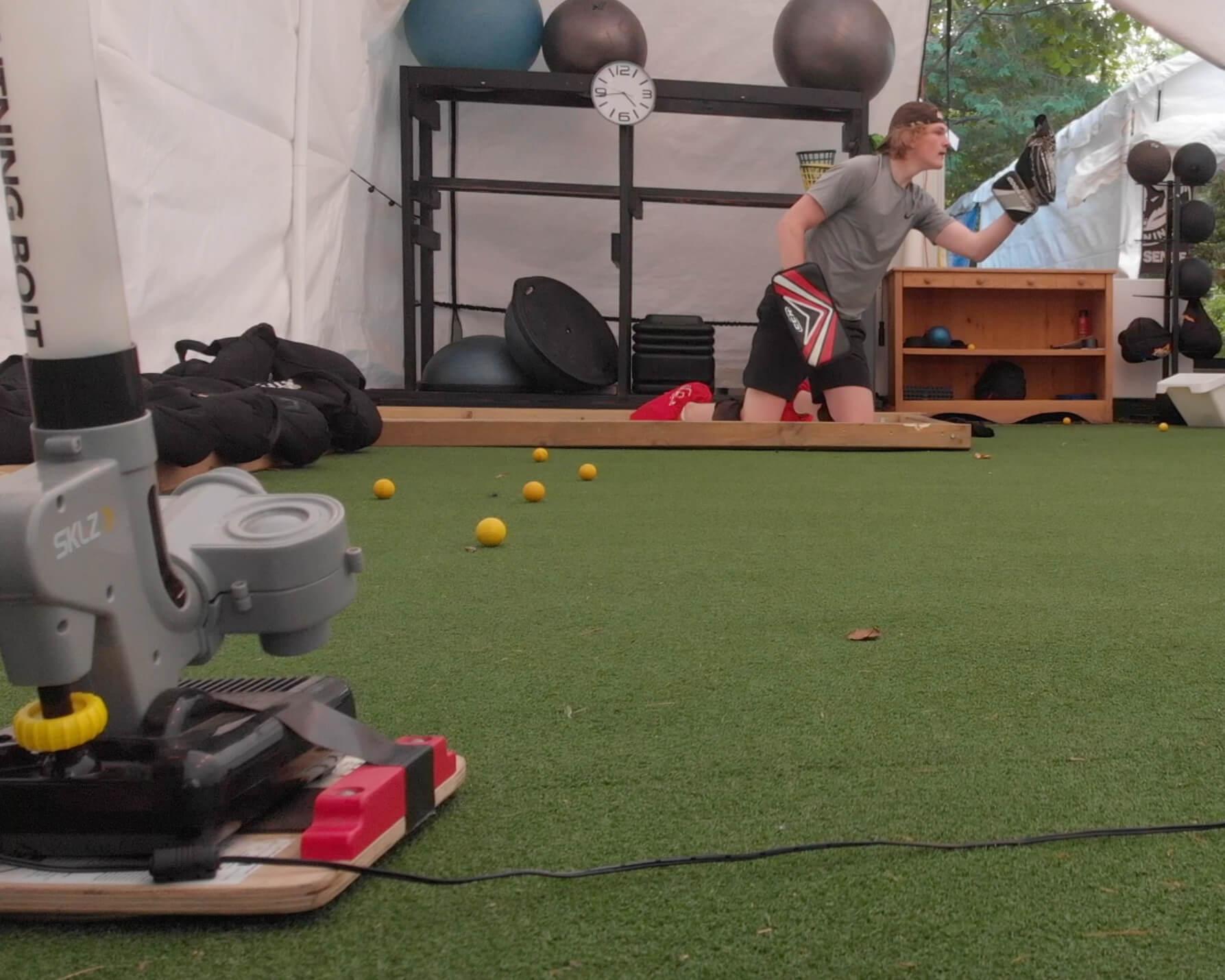 an image of a reaction goalie shooting machine an a goalie making a glove hand catch
