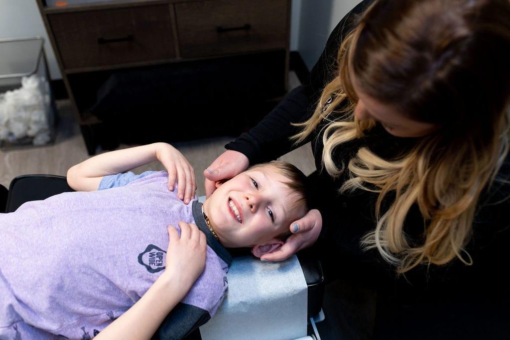 child getting chiropractic adjustment to boost immune system and prevent coronavirus