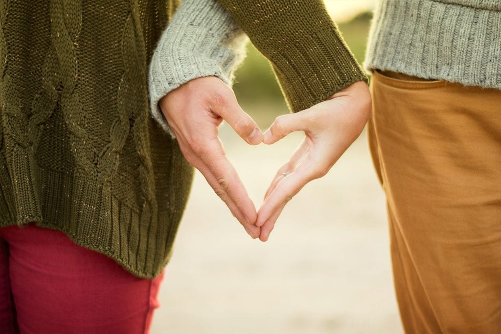 chiropractic for sex life couple hands in heart