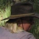 Rusty wears a hat