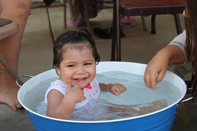 toddler in basin of water
