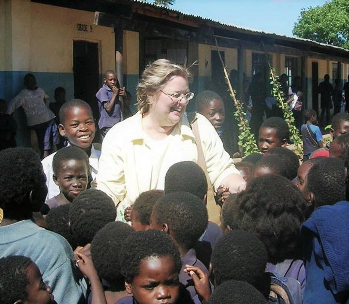 Ilon surrounded by young children in Malawi