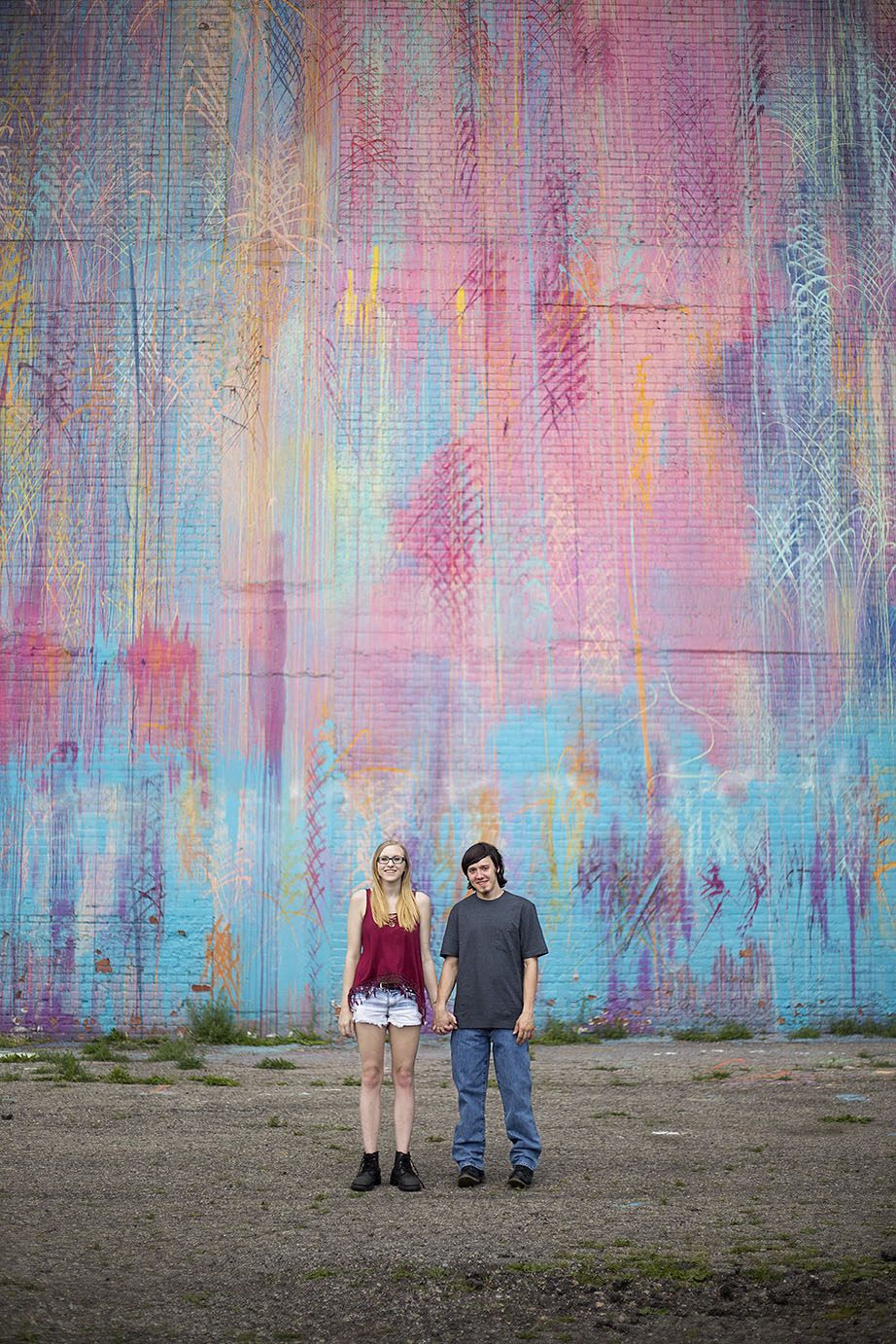 Michigan engaged couple in front of Detroit mural