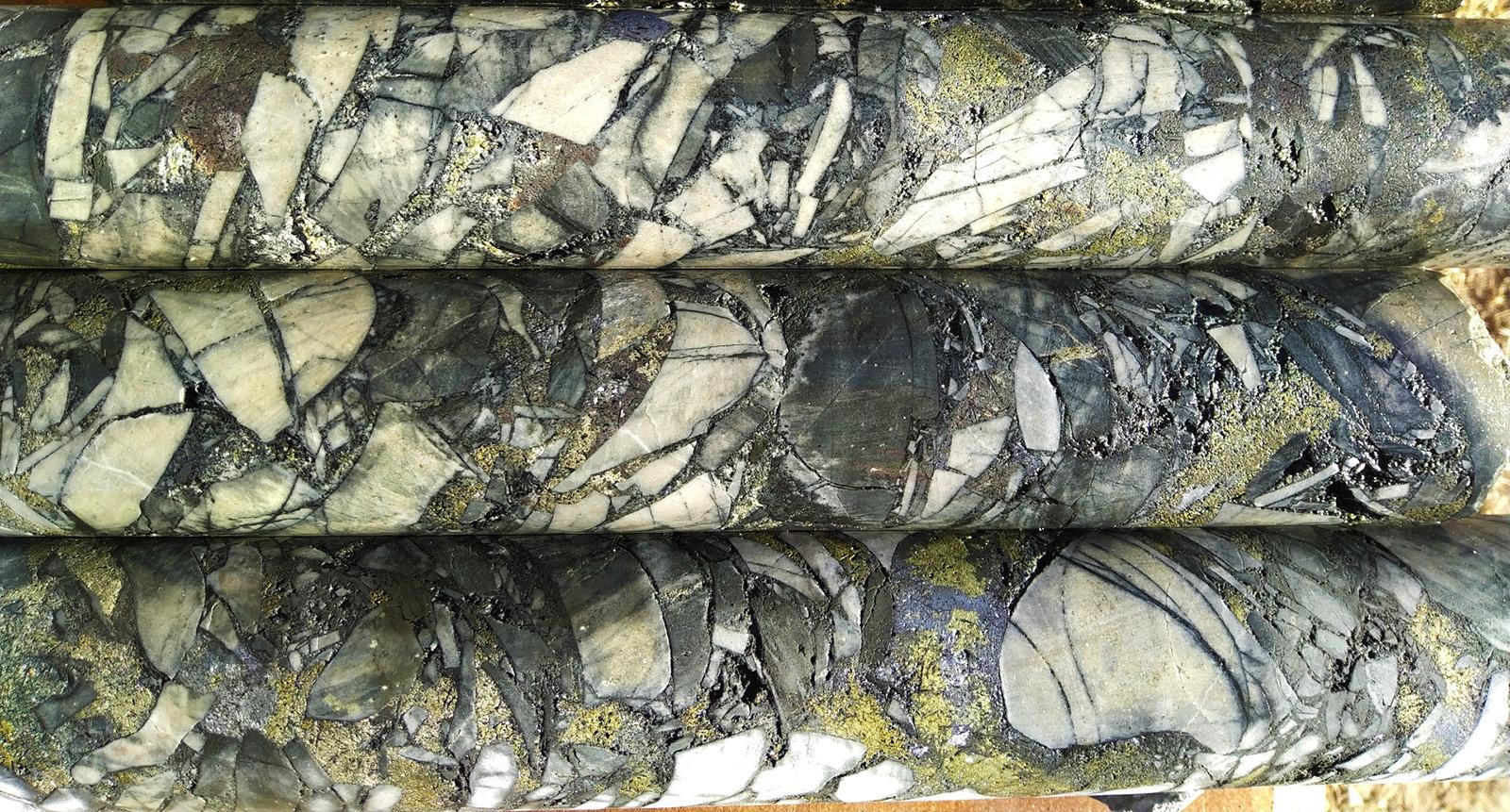 Typical gold-silver-copper-lead-zinc breccia mineralisation: sericite-silica-tourmaline altered clasts of quartzite and siltstone set in a chalcopyrite-pyrite-sphalerite-quartz-tourmaline matrix.