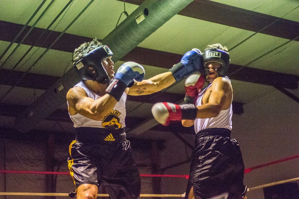 JOED VIERA/STAFF PHOTOGRAPHER Niagara Falls, NY-Joey Morales(blue) and Donte Ettipio(red) trade blows during their boxing match at Casal's Boxing Gym.