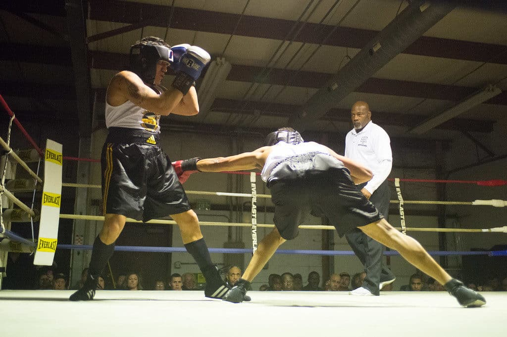 JOED VIERA/STAFF PHOTOGRAPHER Niagara Falls, NY-Joey Morales(blue) dodges a punch thrown by Donte Ettipio(red) during their boxing match at Casal's Boxing Gym.