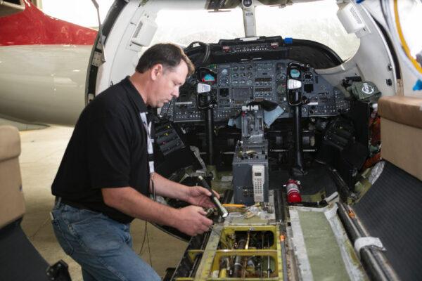 Maintenance Team Working on Engine