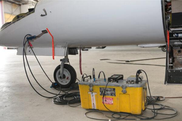 Maintenance Team Working on Learjet