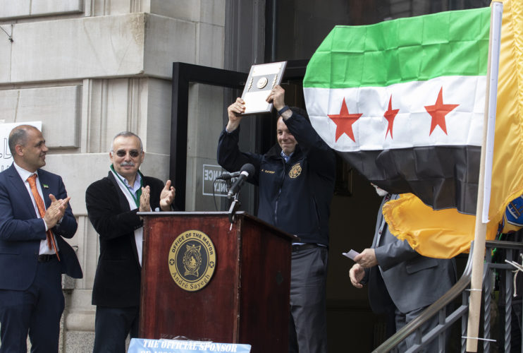 04-20-19 SOUTH PATERSON PROJECT/SYRIAN ANNIVERSARY : Paterson mayor Andre Sayegh is honored with a plaque at the Syrian Independence flag raising ceremony at Paterson City Hall. Sayegh is of Lebanese and Syrian descent.Evacuation Day is Syria's national day commemorating the evacuation of the last French soldier and Syria's proclamation of full independence and the end of the French mandate of Syria on April 17,1946, and does not correlate to the current political strife in Syria, This ceremony did NOT recognize the flag used by the Syrian Government, instead honored the flag used by the Syrian Opposition.   -photo by Thomas E. Franklin *PERMISSION GRANTED TO ROUND EARTH MEDIA